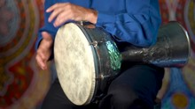 Drumming Rhythm On Metal Turkish Daholla With Arabic Background.