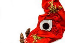 Cup Of Coffee Wrapped In A Orange Scarf On A White Background Is Isolated Stylish Office Table. Autumn Or Winter Concept. Flat Lay, Top View