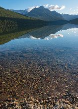 Mountain Reflects In The Mid Morning Light Of Bowman Lake