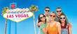travel, summer holidays and leisure concept - group of happy smiling friends in sunglasses hugging over welcome to fabulous las vegas sign background