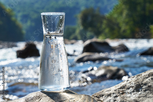 Fotomural  Picture of a glass flask with water.