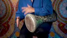 Wide Shot Of Playing Rhythms On Doumbek Drumming Slow Rhythm With Arabic Background.