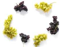 Frame Of Black And Green Grapes Isolated On A White Background. The Pattern Of Grapes Of Different Varieties, Top View. Food Background.
