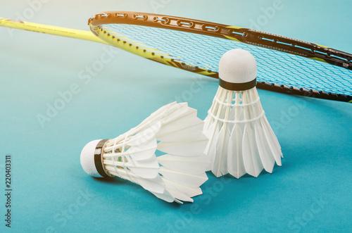 Photo shuttlecock and badminton racket.