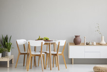 Wooden Chairs At Table In Grey...