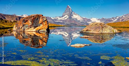 Colorful summer panorama of the Stellisee lake. Great outdoor scene with Matterhorn (Monte Cervino, Mont Cervin) in Swiss Alps, Zermatt location, Valais canton, Switzerland, Europe. #220406596