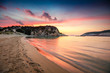 Colorful spring sunrise on Voidokilia beach. Dramatic morning scene of the Ionian Sea, Pilos town location, Greece, Europe. Beauty of nature concept background. Artistic style post processed photo.