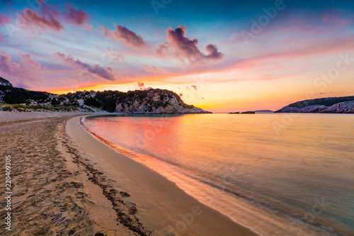 Foto op Aluminium Diepbruine Colorful spring sunrise on Voidokilia beach. Dramatic morning scene of the Ionian Sea, Pilos town location, Greece, Europe. Beauty of nature concept background.
