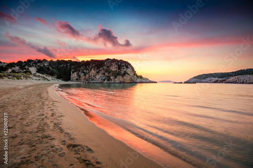 Poster Cappuccino Colorful spring sunrise on Voidokilia beach. Dramatic morning scene of the Ionian Sea, Pilos town location, Greece, Europe. Beauty of nature concept background. Artistic style post processed photo.
