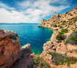 Bright sunny view of Melagavi lighthouse in the Corinth Gulf. Picturesque spring seascape in the Greece, Europe. Beauty of nature concept background. Artistic style post processed photo.