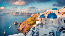 Sunny Morning View Of Santorini Island. Picturesque Spring Sunrise On The Famous Greek Resort Oia, Greece, Europe. Traveling Concept Background. Artistic Style Post Processed Photo.