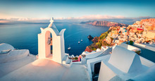 Sunny Morning Panorama Of Santorini Island. Picturesque Spring Sunrise On The Famous Greek Resort Fira, Greece, Europe. Traveling Concept Background. Artistic Style Post Processed Photo.