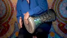 Wide Shot Of Playing Slow Rhythms On Doumbek Drumming Slow Rhythm With Arabic Background.