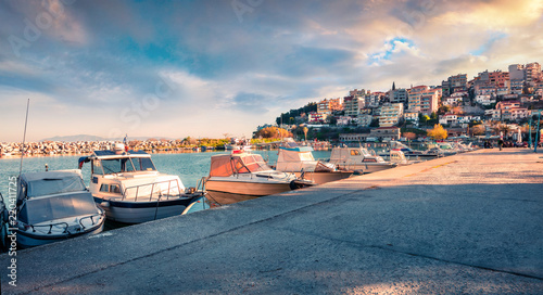 Fototapeta Sunny spring seascape on Aegean Sea. Coloful evening view of Kavala city, the principal seaport of eastern Macedonia and the capital of Kavala regional unit. Greece, Europe. obraz na płótnie