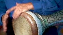 Closeup Of Hands Playing Fast Rolling Rhythm On Clay Doumbek With Fish Skin Head.