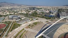 Aerial Shot Flying Next To The Spiro Louis Olympic Stadium With The City Of Athens In The Background