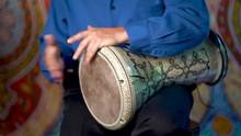 Doumbek Drumming Slow Rhythm With Arabic Background.