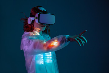 Woman touching air in VR gl...