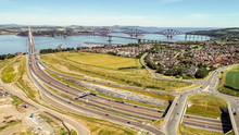 Aerial Image Of Traffic On The Approach Roads To The Queensferry Crossing Bridge Near Edinburgh.