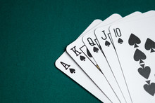 Royal Flush Combination Cards On Green Table For Poker Game