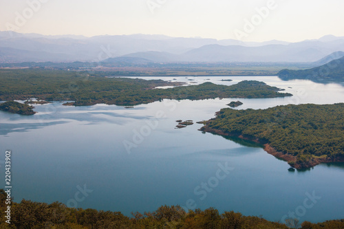 Foto op Aluminium Blauwe jeans Beautiful summer landscape with a picturesque lake and many small islands. Montenegro, view of Salt Lake near town of Niksic