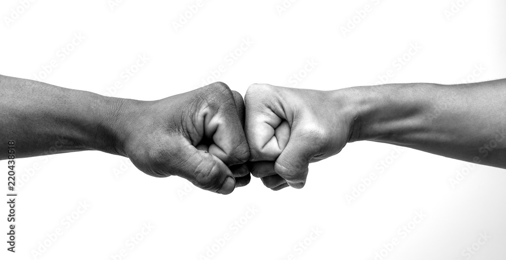 Fototapeta Man giving fist bump, monochrome, black and white image.