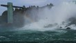 niagra falls seen from a boat with birds and a rainbow from the water canadian side