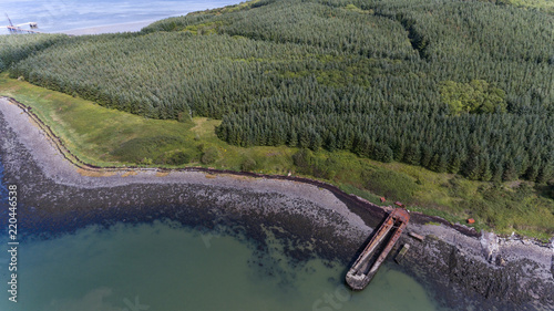 Aerial view of Old rusty abandoned shipping Barge On The River Shannon in the Republic of Ireland