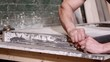 Taking of the edge for a new concrete worktop, Slow motion 4K