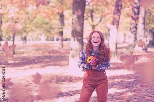 Valokuva  happy woman in autumn with red hair