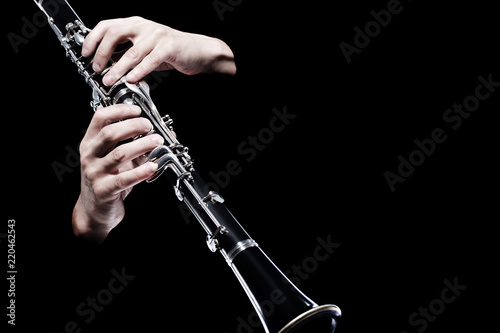 Foto auf Gartenposter Musik Clarinet player hands isolated