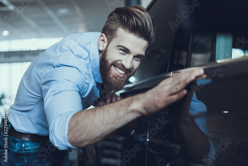 Fotografiet  Portrait of Handsome Buisiness Man Enjoying Car