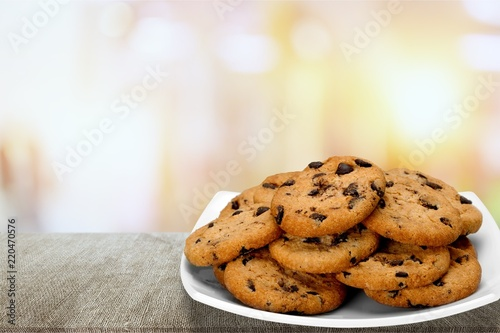 Garden Poster Cookies Plate of chocolate chip cookies isolated on white background