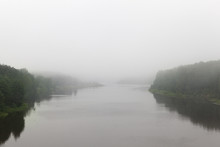 River In Cloudy Foggy Weather