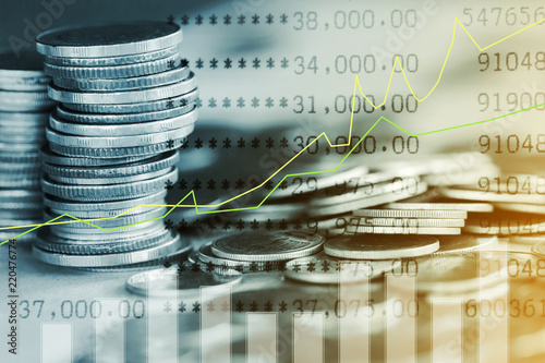 Photo  Stack of coins with growing graph for business finance concept
