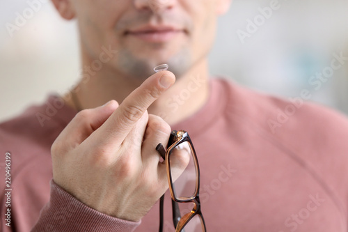 Man holding contact lens and glasses, closeup Canvas Print