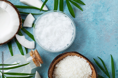 Set of organic coconut products for spa, cosmetic or food ingredients. Oil, water and shavings top view. Flat lay.