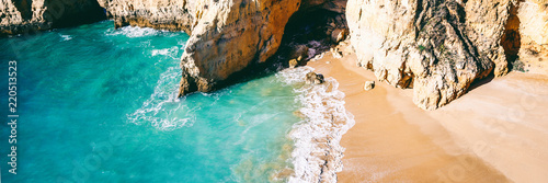 Obraz na płótnie Panoramic view of a beautiful stunning beach with turquoise water and rocks, vie