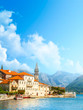 Harbour and boats in sunny day at Boka Kotor bay, Montenegro, Europe