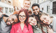 canvas print picture Happy friends from diverse cultures and races taking selfie with back lighting - Youth, millennial generation and friendship concept with young people having fun together