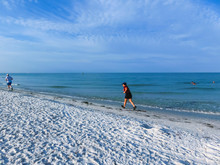 The People Running At Beach Walking On Siesta Key Beach With White Sand.