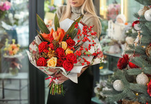 Female Florist Holding Beautif...