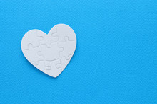 Top View Image Of Paper White Heart Puzzle Over Blue Background. Health Care, Donate, World Heart Day And World Health Day Concept.