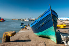 A Small Fishing Boat Is Strand...