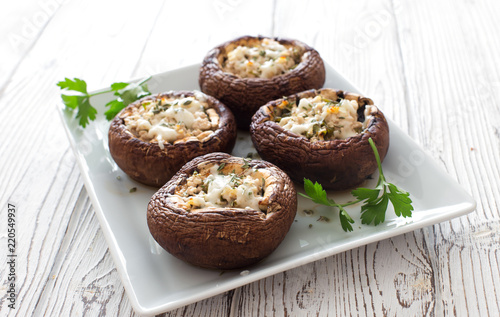Fototapeta Mushrooms stuffed with cheese and greens obraz