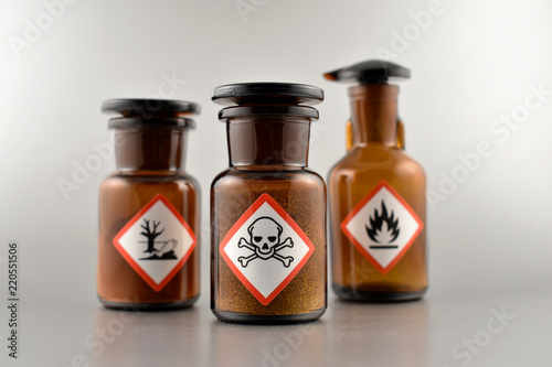 Printed kitchen splashbacks Spices Vial with warning pictogram stock images. Laboratory accessories. Vials on a silver background. Brown glass containers. Brown chemical glass