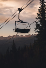 A Silhouette Of A Chair Lift In Vail, Colorado With Mountains In The Background.