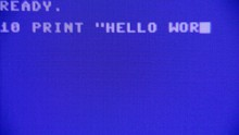 Writing A Simple Hello World Program On A Retro Vintage Computer, Listing And Running It. Macro Detail Screen.