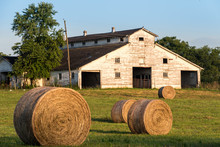 Barn With Hay Bales In Summer