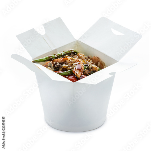 Wok rice with eel and salmon in paper box over white. With clipping path.